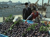 Little boy selling fruit and putting it in a bag Stock Footage