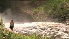 Minnehaha Falls with young woman Stock Footage