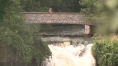 Minnehaha Falls bridge pull to wide Stock Footage
