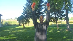 Man Juggling Apples Outdoors Stock Footage