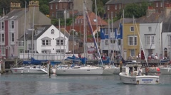 The old harbour and waterfront at Weymouth with sailboats and fishing boat - stock footage