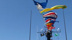 Signal flags flying against blue sky   10167 Stock Footage