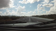 Traveling through the Arizona desert with sudden rain and blue skies - 2 Stock Footage