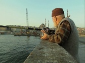 Close up of man fishing off bridge Stock Footage