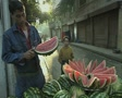 Seller preparing watermelon at stall Footage