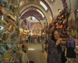 Shot of indoor market passage with people passing through Footage