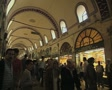 Shot of indoor market passage with passing people Footage