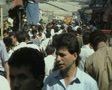 Close up of crowd walking in outdoor market Footage