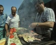Close up of street food seller cooking meat SD Footage