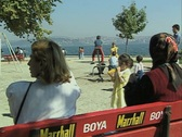 View of playground and people sitting on bench Stock Footage