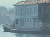 Shot of passing riverside buildings taken from boat Stock Footage