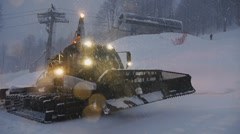 Snowcat in the snow Stock Footage