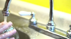 Dishes in sink being washed pan shot Stock Footage