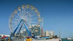 Ferris wheel along Daytona Beach ocean walk Stock Footage