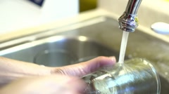 Washing glass in sink close up Stock Footage