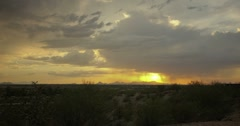 2K 30p Arizona dramatic monsoon sunset in time lapse with storm clouds and rain Stock Footage