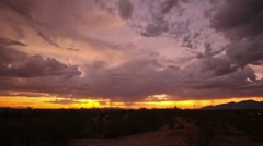 HD 30p Orange sky with rain clouds after sunset time lapse Stock Footage