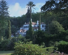 View of white building surrounded by garden Stock Footage