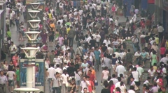 Busy, crowded shopping street in China Stock Footage