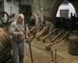 Men making barrels inside museum SD Footage