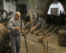 Men making barrels inside museum Stock Footage