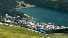 Chantarella-Bahn Cable car going uphill from St.Moritz, Grisons, Switzerland Stock Footage