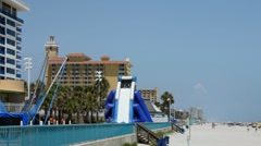 Water Slide and amusements along Daytona Beach ocean walk Stock Footage