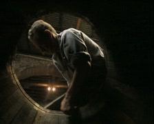 Shot of man crafting barrel viewed through barrel Stock Footage