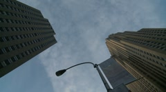 Looking up at NYC skyscrapers, timelapse clouds - stock footage