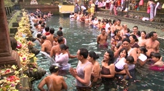 Spiritual bath in sacred pool with holy spring and fountains line up Stock Footage