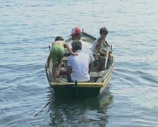 Boys getting into rowboat Stock Footage