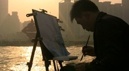 Stock Video Footage of Chinese artist paints skyline at sunset