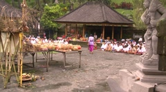 Traditional Balinese prayer ritual in courtyard Stock Footage