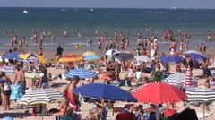 Beach crowd during summertime Stock Footage