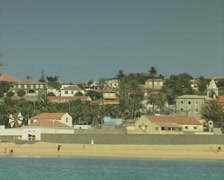 View of beach and coastal buildings from moving boat Stock Footage