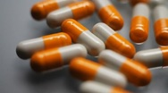 Orange capsule Medications Stock Footage