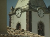 Zoom out from church clock face to building Stock Footage