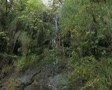 Pan down of small waterfall Footage