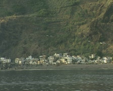 Coast and coastal buildings from moving boat Stock Footage