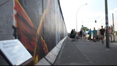 East Side Gallery - remnants of the Berlin Wall in Friedrichshain in Berlin - stock footage