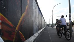 East Side Gallery - remnants of the Berlin Wall in Friedrichshain in Berlin Stock Footage