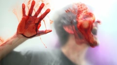 Bloody face slammed against frosted glass Stock Footage