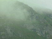 Zoom out from lake, mountain and mist Stock Footage