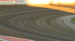 Speedway racers sliding through the curve - stock footage