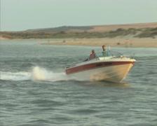 Passing speedboat and waterskiier Stock Footage