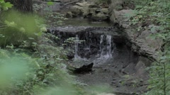waterfall in the woods - stock footage