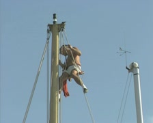 Man sitting at top of boat mast Stock Footage