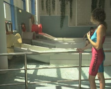 Lifeguard at base of waterslides Stock Footage