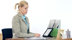 Young businesswoman chatting on tablet computer in the office HD Stock Footage