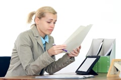 Young businesswoman overwhelmed by too much paperwork NTSC Stock Footage